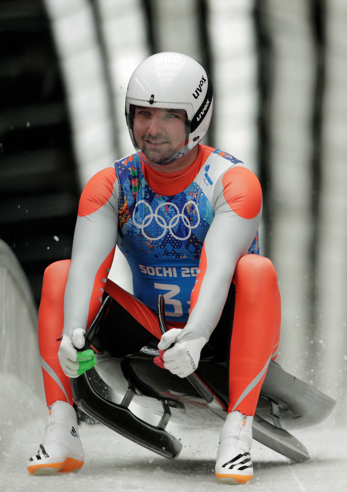 . Maciej Kurowski of Poland finishes a run during the Luge Relay on Day 6 of the Sochi 2014 Winter Olympics at Sliding Center Sanki on February 13, 2014 in Sochi, Russia.  (Photo by Adam Pretty/Getty Images)