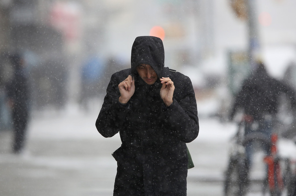 . A person walks during a snowstorm on January 21, 2014 in New York City. Areas of the Northeast are predicted to receive up to a foot of snow in what may be the biggest snowfall of the season so far.  (Photo by John Moore/Getty Images)