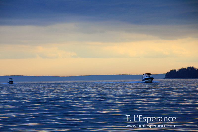 Sister power boats coming in before the storm... electric blue light on St. Margaret's Bay, Nova Scotia.