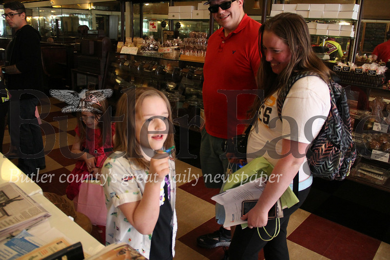Sawyer Painter carrys his pipe brush cleaner figure into Cummings Coffe with his family on Saturday.