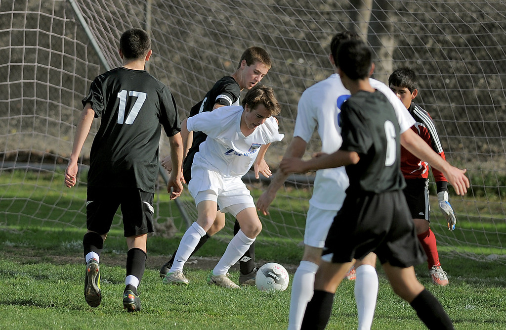 . 02-15-2012--(LANG Staff Photo by Sean Hiller)- Los Alamitos beat Buena 4-1 in the first round of the Division 1 boys soccer playoffs Friday at Laurel School in Los Alamitos. Brett Hall (20) makes a first half goal.
