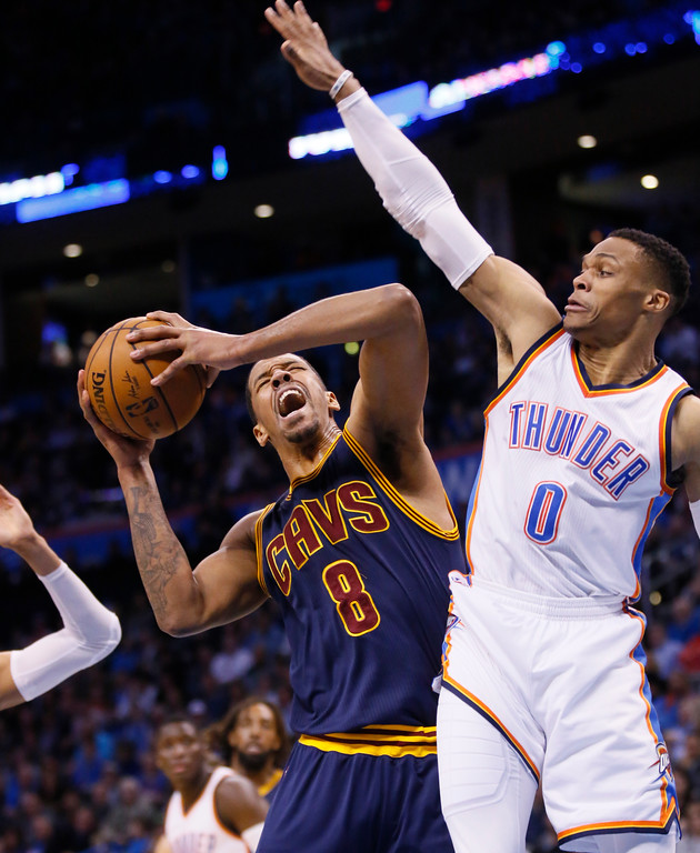 . Cleveland Cavaliers forward Channing Frye (8) is fouled by Oklahoma City Thunder guard Russell Westbrook (0) during the second quarter of an NBA basketball game in Oklahoma City, Thursday, Feb. 9, 2017. (AP Photo/Sue Ogrocki)