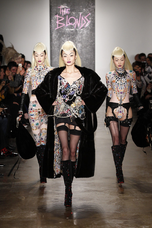 . A model walks the runway at the The Blonds fashion show during Fall 2014 MADE Fashion Week Fall 2014 at Milk Studios on February 12, 2014 in New York City.  (Photo by Joe Kohen/Getty Images)
