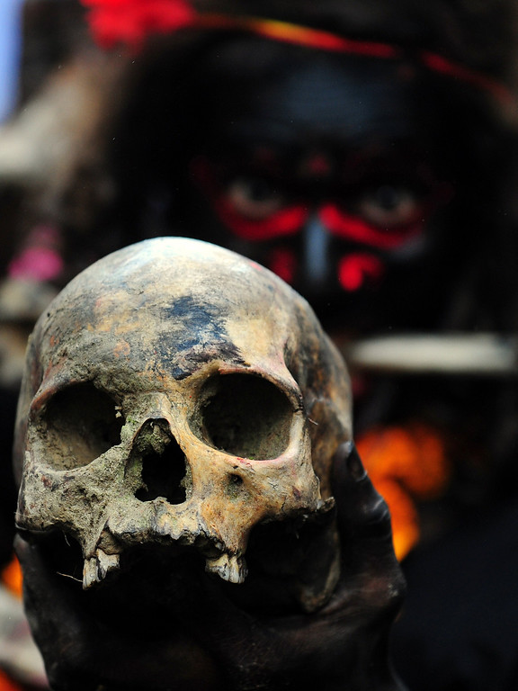 . An Indian Hindu devotee holds a human skull during a procession for Maha Shivaratri, dedicated to the Hindu god Lord Shiva, in Allahabad on February 27, 2014. AFP PHOTO/SANJAY  Kanojia/AFP/Getty Images