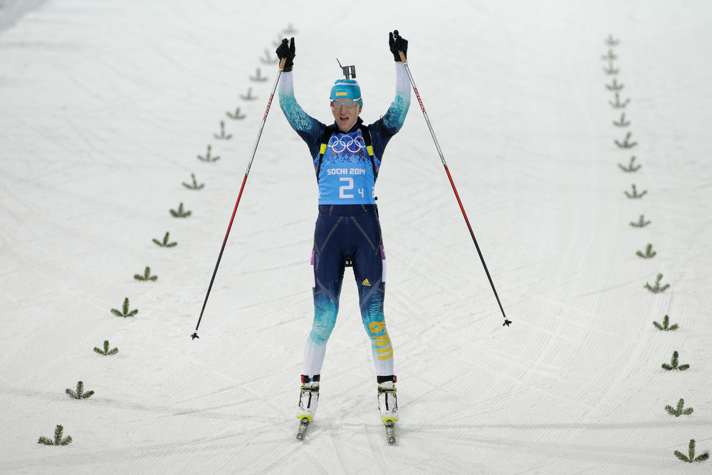 . Gold medalist Olena Pidhrushna of Ukraine celebrates as she crosses the finish line to win the Women\'s 4 x 6 km Relay during day 14 of the Sochi 2014 Winter Olympics at Laura Cross-country Ski & Biathlon Center on February 21, 2014 in Sochi, Russia.  (Photo by Adam Pretty/Getty Images)