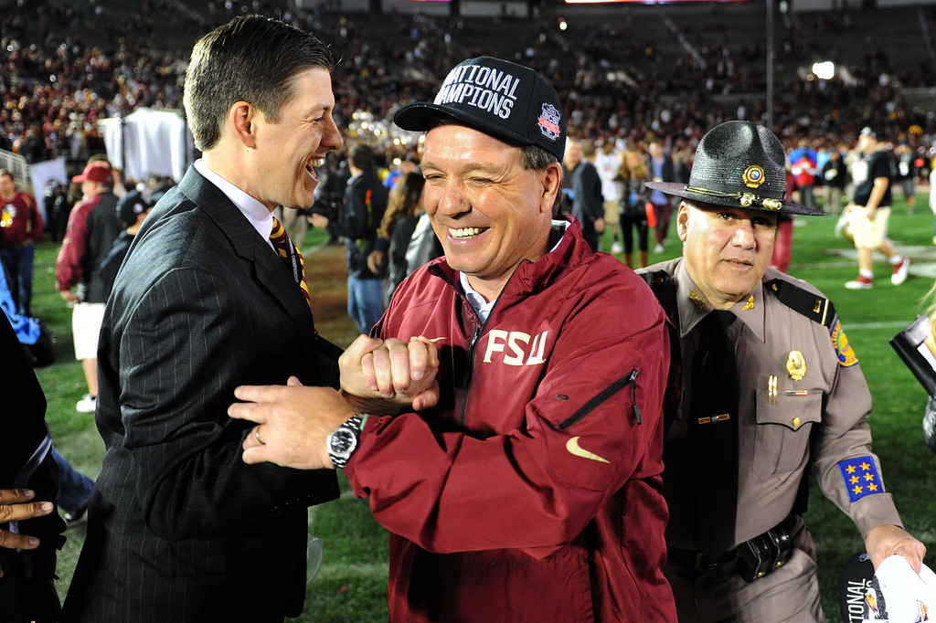 . Florida State head coach Jimbo Fisher is congratulated after beating Auburn 34-31 in the BCS national championship game at the Rose Bowl, Monday, January 6, 2014. (Photo by Michael Owen Baker/L.A. Daily News)