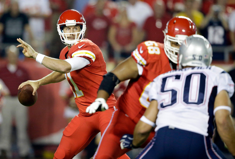 . Kansas City Chiefs quarterback Alex Smith throws during the first quarter of an NFL football game against the New England Patriots, Monday, Sept. 29, 2014, in Kansas City, Mo. (AP Photo/Nati Harnik)