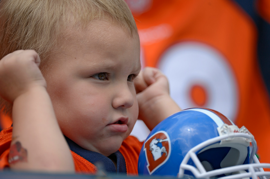 . Denver Broncos fan Jaxon Morrison 3 years old pumps his fist as the team hits the field on day four of the Denver Broncos 2014 training camp July 27, 2014 at Sports Authority Field at Mile High. (Photo by John Leyba/The Denver Post)