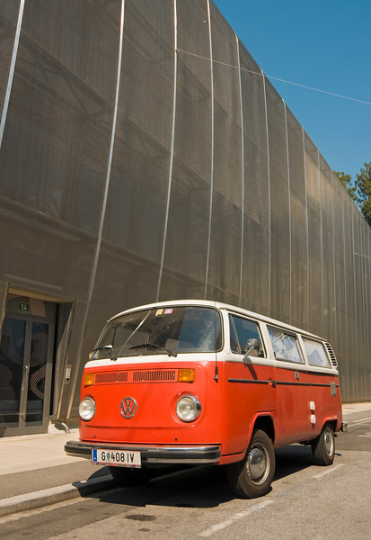 Classic Red VW (Volkswagen) T2 Van outside MUMUTH (House of Music and Music Drama) Buidling, Kunst University Graz, Austria