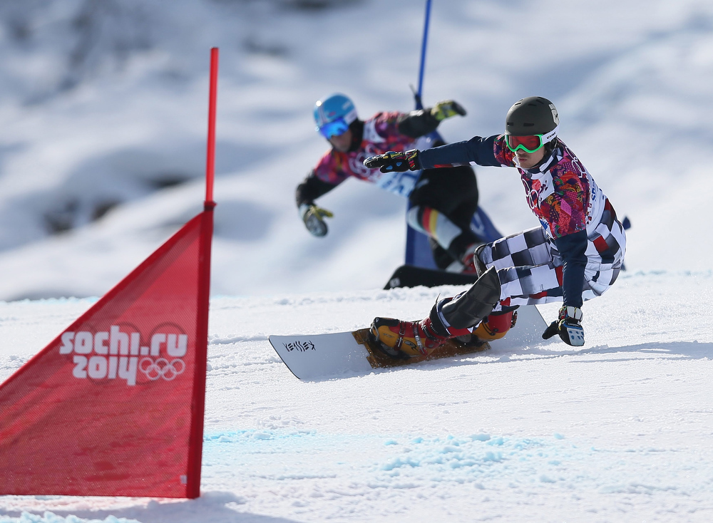 . Vic Wild (R) of Russia leads Patrick Bussler of Germany in the semi final of the men\'s Snowboard Parallel Giant Slalom at Rosa Khutor Extreme Park at the Sochi 2014 Olympic Games, Krasnaya Polyana, Russia, 19 February 2014.  EPA/SERGEY ILNITSKY