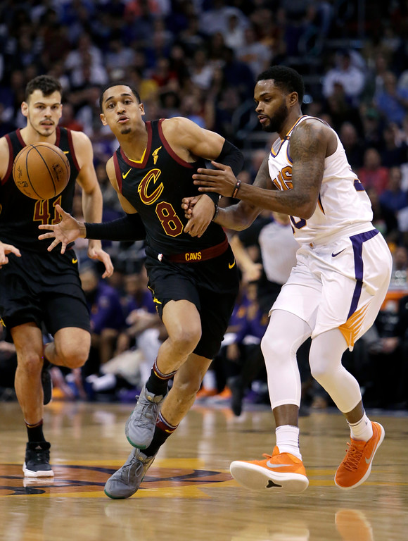 . Cleveland Cavaliers guard Jordan Clarkson (8) drives on Phoenix Suns guard Troy Daniels in the first half during an NBA basketball game, Tuesday, March 13, 2018, in Phoenix. (AP Photo/Rick Scuteri)