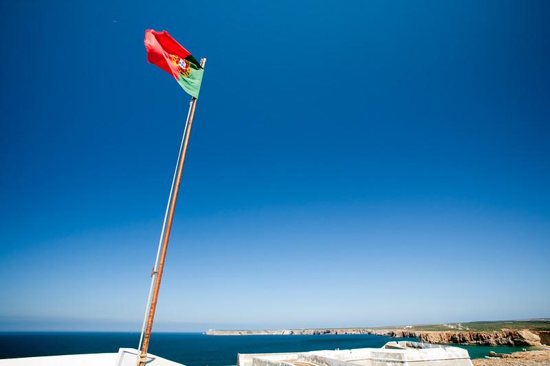 The Portuguese flag at the fortress of Sagres, municipality of Vila do Bispo, district of Faro, region of Algarve, southwestern Portugal