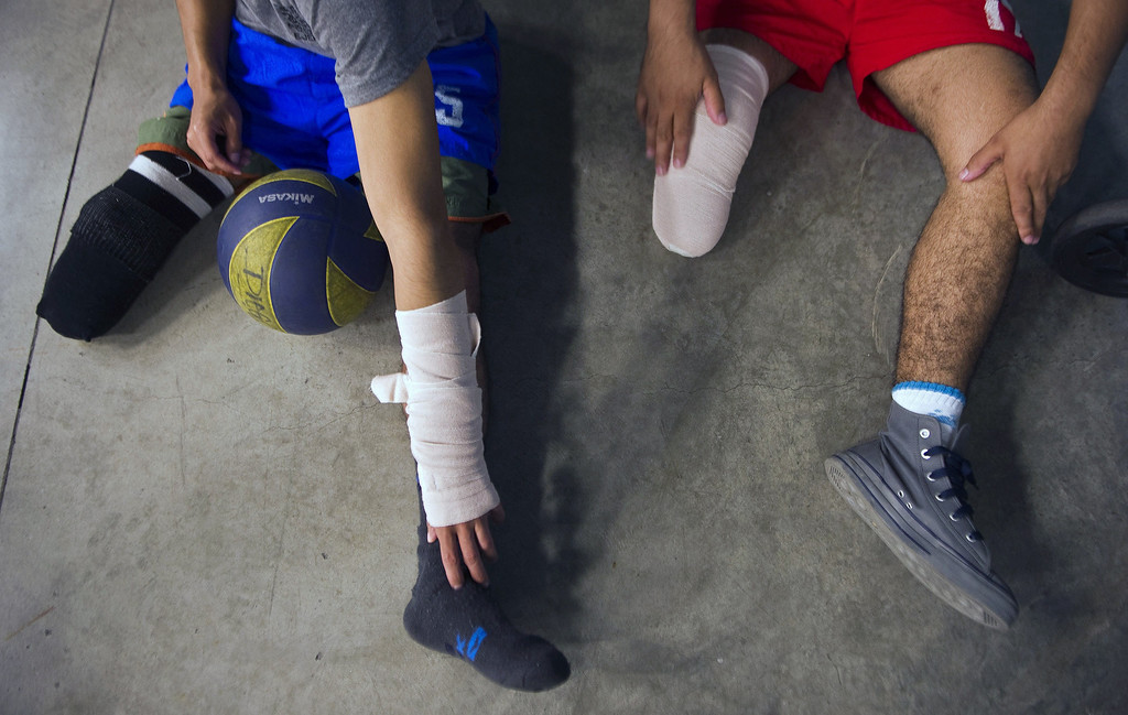 . Colombian soldiers victims of land mine explosions get ready for a volleyball game during their rehabilitation therapy session at the Heroes de Paramillo hospital in Medellin,  Colombia on September 11, 2013.  RAUL ARBOLEDA/AFP/Getty Images