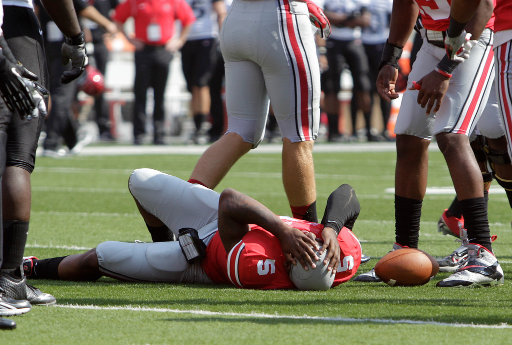 . Ohio State quarterback Braxton Miller lies on the ground after being injured during the first quarter of an NCAA college football game against San Diego State on Saturday, Sept. 7, 2013, in Columbus, Ohio. (AP Photo/Jay LaPrete)