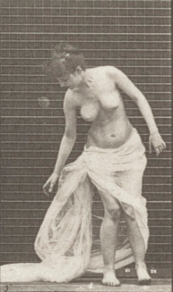 Semi-nude woman stooping to lift train and turning