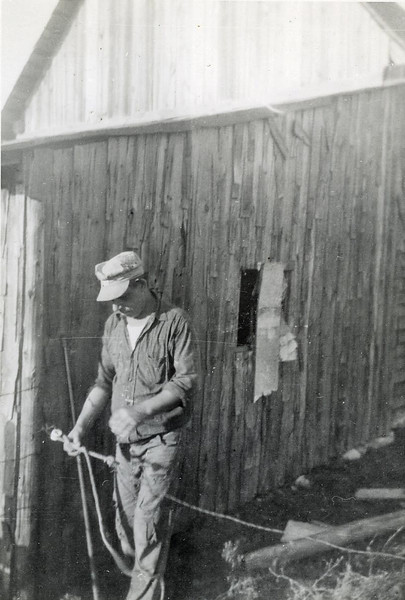 Bill Foote working on the farm