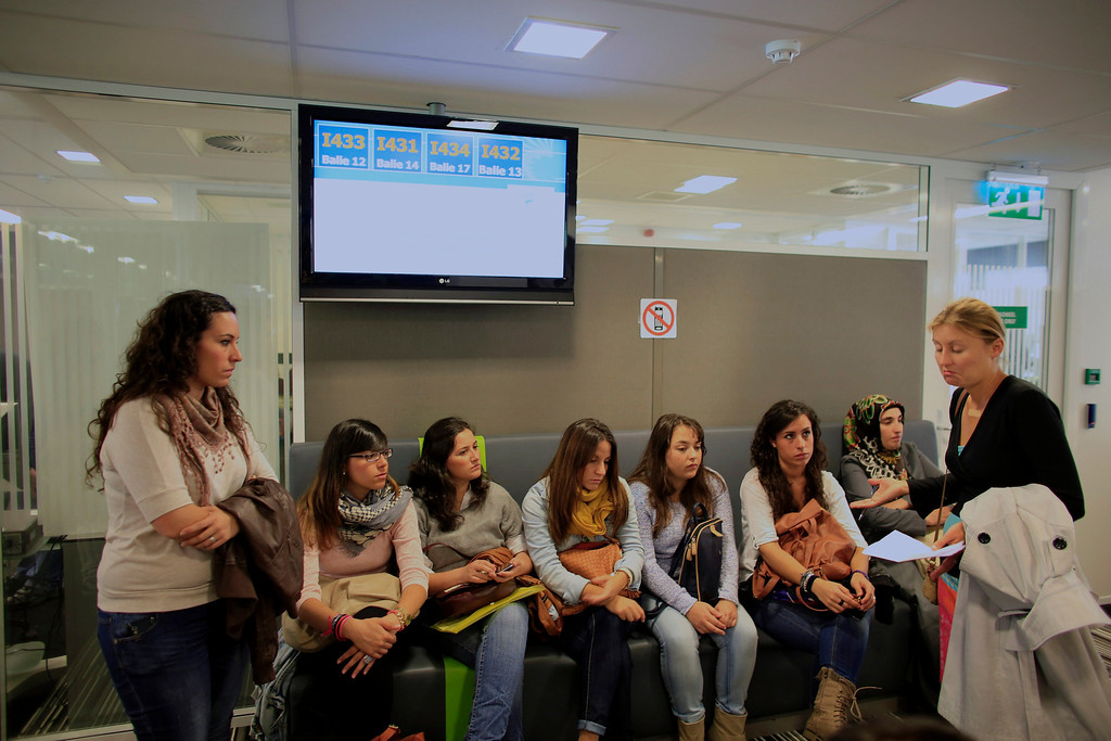 . Spanish nurses Maria Jose Marin (3rd R), 23,  her twin sister Maria Teresa (L) and other members of their group, register for work at an immigration office in The Hague, June 5, 2013. After months of studying Dutch, a group of young Spanish nurses moved to the Netherlands to take up work, fleeing a dismal job market at home. Spain\'s population dropped last year for the first time on record as young professionals and immigrants who moved here during a construction boom head for greener pastures. Spain\'s jobless rate is 27 percent, and more than half of young workers are unemployed. For Spanish nurses, the Netherlands\' nursing deficit is a boon. Picture taken June 5, 2013.  REUTERS/Marcelo del Pozo