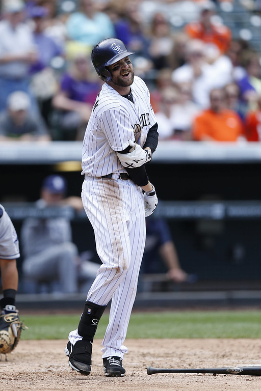 . Ben Paulsen #4 of the Colorado Rockies reacts after being hit by a pitch against the San Diego Padres during the game at Coors Field on September 7, 2014 in Denver, Colorado. The Rockies won 6-0. (Photo by Joe Robbins/Getty Images)
