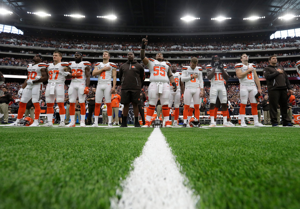 . The Cleveland Browns stand during the playing of the national anthem before an NFL football game against the Houston Texans on Sunday, Oct. 15, 2017, in Houston. (AP Photo/Eric Gay)