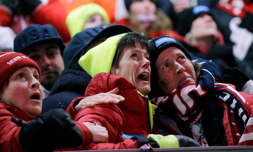 . Sue Sweeney, center, the mother of Emily Sweeney of the United States, cries out as her daughter crashes on the final run during the women\'s luge final at the 2018 Winter Olympics in Pyeongchang, South Korea, Tuesday, Feb. 13, 2018. (AP Photo/Wong Maye-E)