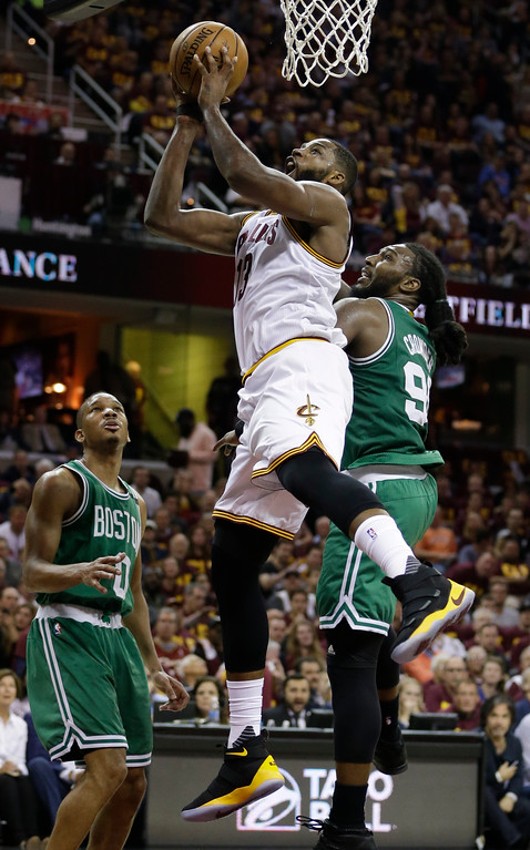 . Cleveland Cavaliers\' Tristan Thompson (13) shoots against Boston Celtics\' Jae Crowder (99) and Avery Bradley (0) during the second half of Game 3 of the NBA basketball Eastern Conference finals, Sunday, May 21, 2017, in Cleveland. (AP Photo/Tony Dejak)