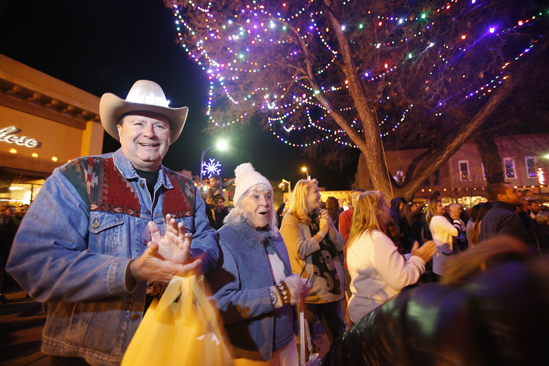 Dr William Wood, of Double Oak, TX, and his wife Patsy Wood, react during the Holiday Lighting on the Plaza on Friday, November 24, 2017, moments after the lights went on. The Woods have come to Santa Fe for the last 26 years. Luis Sánchez Saturno/The New Mexican
