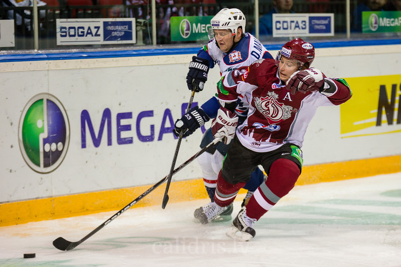 Makarov Dmitry (23) and Rodrigo Lavins (2) try to reach for the puck