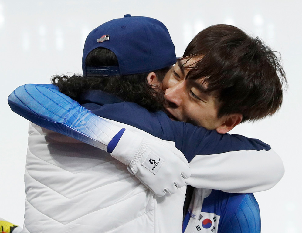 . Korea\'s coach Bob de Jong of The Netherlands, hugs gold medalist Lee Seung-hoon of South Korea after the men\'s mass start speedskating race at the Gangneung Oval at the 2018 Winter Olympics in Gangneung, South Korea, Saturday, Feb. 24, 2018. (AP Photo/John Locher)