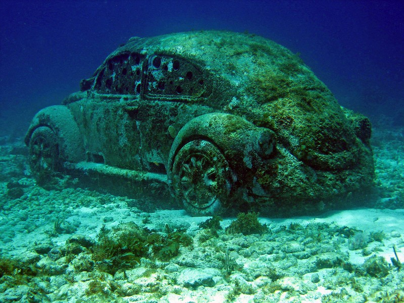 """V"" is for Volkswagen and yes, this one is underwater.  In Isla Mujeres Mexico it is part of an underwater museum.  For this unique museum, they hired English sculptor Jason deCaires Taylor. Today, MUSA consists of over 500 permanent life-sized and monumental sculptures and is one of the largest and most ambitious underwater artificial art attractions in the world.  http://musamexico.org/"