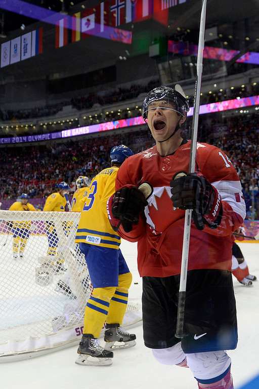 . Chris Kunitz (14) of Canada celebrates his 3-0 goal against Sweden during the third period of Canada\'s 3-0 win in the men\'s ice hockey gold medal game against Sweden. Sochi 2014 Winter Olympics on Sunday, February 23, 2014 at Bolshoy Ice Arena. (Photo by AAron Ontiveroz/ The Denver Post)