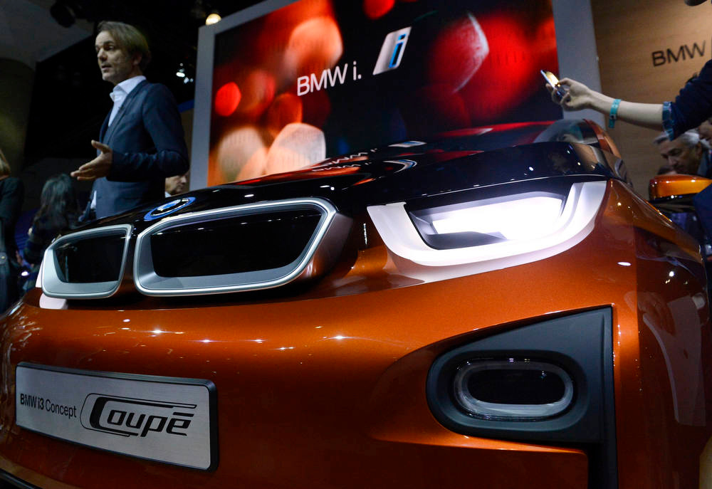 Description of . The BMW i3 concept car is displayed during a news conference at the 2012 Los Angeles Auto Show in Los Angeles, California November 28, 2012.  REUTERS/Phil McCarten