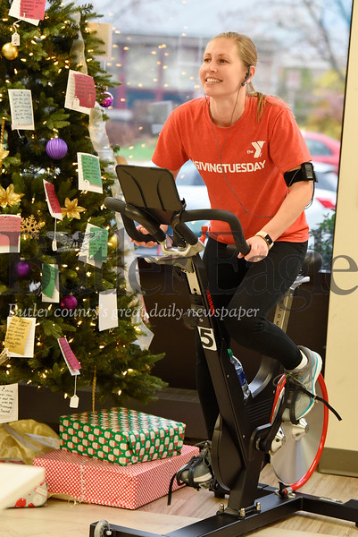 Harold Aughton/Butler Eagle: Brenda McGuire, a retention specialist at the Butler YMCA took her turn riding the stationary bike to raise funds during the Day of Giving, Tues., Dec. 3, 2019.