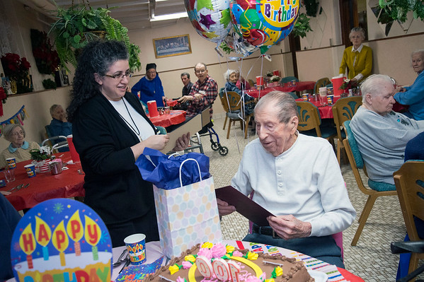 01/13/20 Wesley Bunnell | StaffrrAlexander Wojtera celebrated his 100th birthday at St. Lucian&quote;s Residence on Monday evening featuring proclamations received from the offices of Mayor Erin Stewart and Congresswoman Jahana Hayes and an upcoming honor from President Donald Trump which will arrive soon. St. Lucian's Administrator KellyAnn Carpentier hands Wojtera a proclamation.