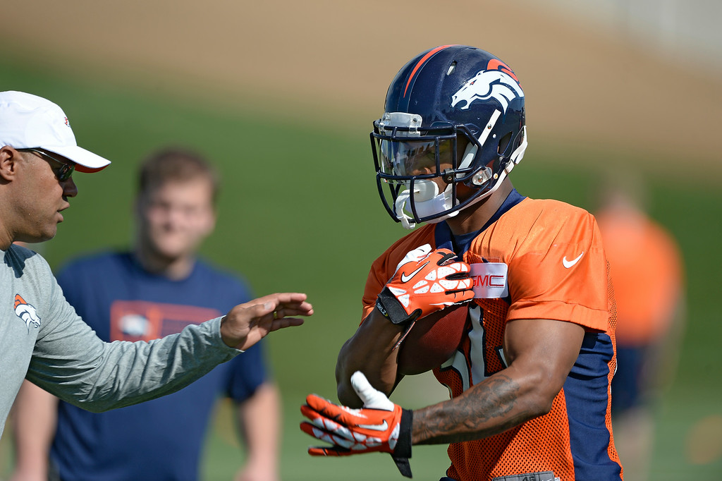 . Denver Broncos running back Brennan Clay (34) runs through drills during the first day of the Denver Broncos 2014 training camp July 24, 2014 at Dove Valley. (Photo by John Leyba/The Denver Post)