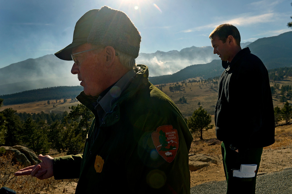 . Larry Frederick, left, and Jake Brollier, Public Information Officers on the Fern Lake Fire, talk about the progress firefighters are making on the fire and the worry about winds kicking up later in the afternoon on December 2, 2012.