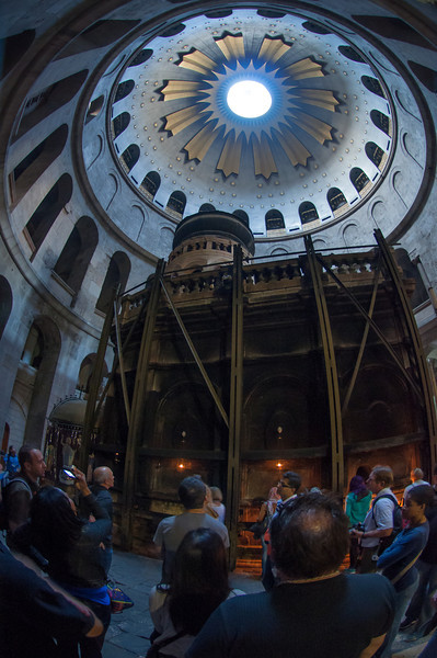 Inside the Church of the Holy Sepulchre in historic Jerusalem, Israel. The structure in the center is built up around the believed location of Jesus' burial tomb.