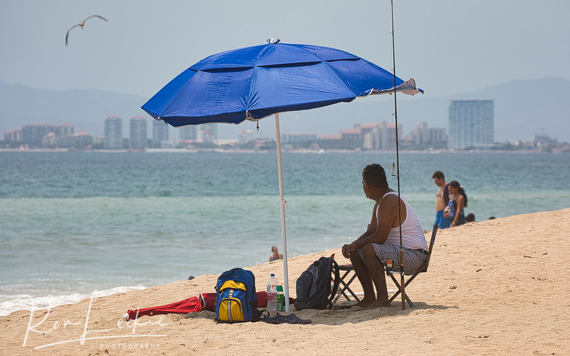 Fisherman relaxes on the beach
