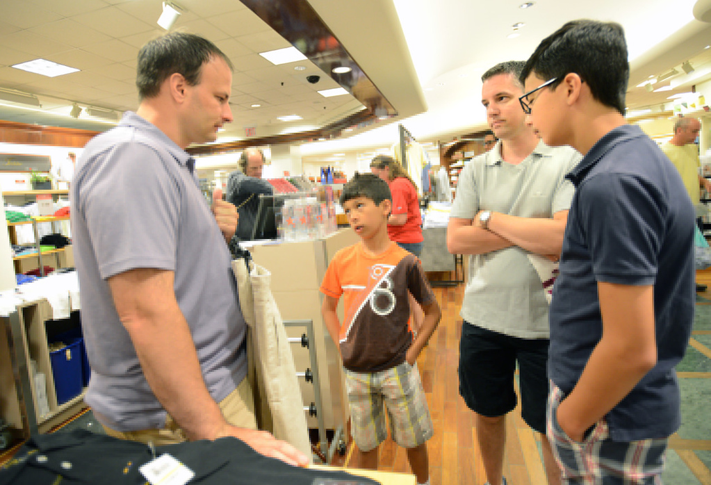 . Bradley Weber, left, and Ryan Pfeifle wait for a salesperson to assist them while shopping for wedding clothes at Macy\'s in the Mall of America. With them are their sons, Kyle Pfeifle-Weber, 13, right, and Josh Pfeifle-Weber, 11. (Pioneer Press: Chris Polydoroff)
