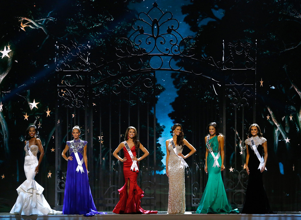 . Miss Georgia USA Tiana Griggs, from left, Miss Louisiana USA Brittany Alyson Guidry, Miss Nevada USA Nia Sanchez, Miss Florida USA Brittany Oldehoff, Miss North Dakota USA Audra Mari and Miss Iowa USA Carlyn Bradarich, stand during the Miss USA pageant in Baton Rouge, La., Sunday, June 8, 2014. Sanchez would go on to win the Miss USA title. (AP Photo/Jonathan Bachman)