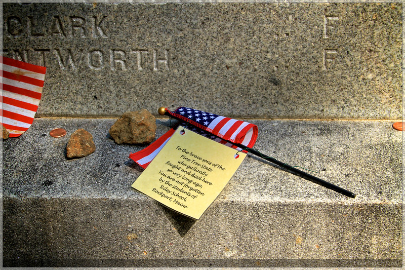 Flags placed on the 20th Maine memorial.