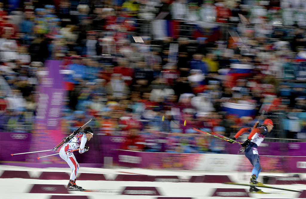 . Jean-Guillaume Beatrix of France takes 3rd place during the Biathlon Men\'s 12.5km Pursuit at the Laura Cross-country Ski & Biathlon Center on February 10, 2014 in Sochi, Russia. (Photo by Vianney Thibaut/Agence Zoom/Getty Images)