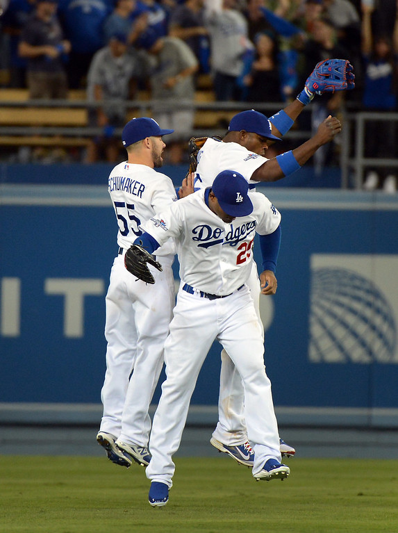 . Los Angeles Dodgers\' outfielders celebrate the 13-6 win during game 3 of the NLDS at Dodger Stadium Sunday, October 6, 2013. (Photo by David Crane/Los Angeles Daily News)
