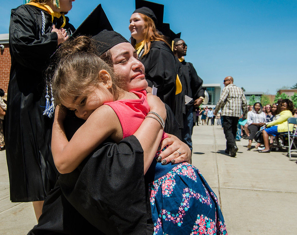 . Elsa Rodriguez, of Worcester, gets emotional as she gets a hug from four-year-old daughter Elisia Toro during the 121st Undergraduate Spring Commencement Ceremony at Fitchburg State University on Saturday, May 20, 2017. SENTINEL & ENTERPRISE / Ashley Green