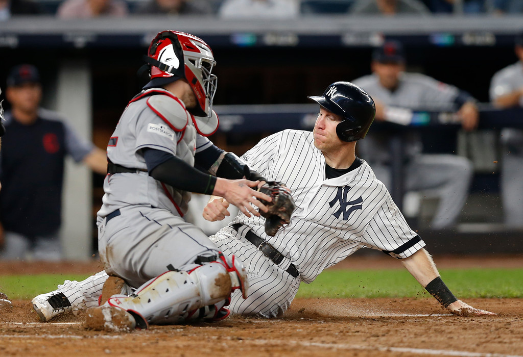 . New York Yankees\' Todd Frazier slides safely into home plate ahead of the tag from Cleveland Indians catcher Roberto Perez on a sacrifice fly by Brett Gardner during the fifth inning in Game 4 of baseball\'s American League Division Series, Monday, Oct. 9, 2017, in New York. (AP Photo/Kathy Willens)
