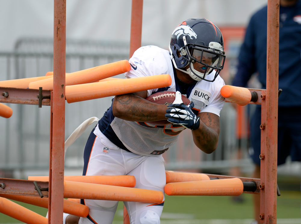 . Denver Broncos RB Lance Ball (35) rungs through drills during training camp July 29, 2013 at Dove Valley. (Photo By John Leyba/The Denver Post)