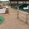 green sand pit digger and customised slides on mound and pumpkin sculptures