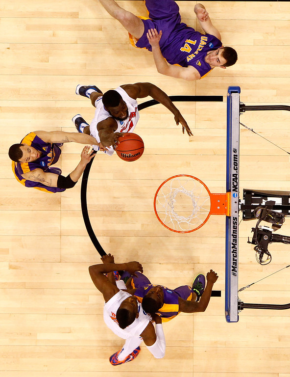 . ORLANDO, FL - MARCH 20:  Patric Young #4 of the Florida Gators dunks the ball as Sam Rowley #14 of the Albany Great Danes looks on during the second round of the 2014 NCAA Men\'s Basketball Tournament at Amway Center on March 20, 2014 in Orlando, Florida.  (Photo by Kevin C. Cox/Getty Images)