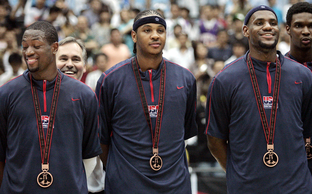 . USAs players from left to right.,Dwyane Wade, Carmelo Anthony, and LeBron James stand pose for photo after their team won the third place  of the World Basketball Championships in Saitama, Japan, Saturday, Sept. 2, 2006. (AP Photo/Dusan Vranic)
