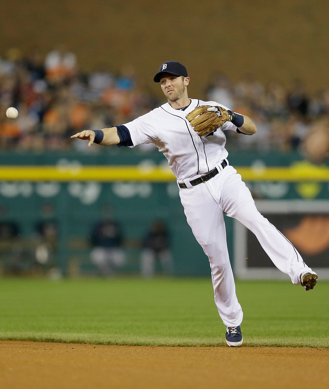 . Detroit Tigers second baseman Ian Kinsler throws out Minnesota Twins\' Oswaldo Arcia during the fourth inning of a baseball game in Detroit, Saturday, Sept. 27, 2014. (AP Photo/Carlos Osorio)