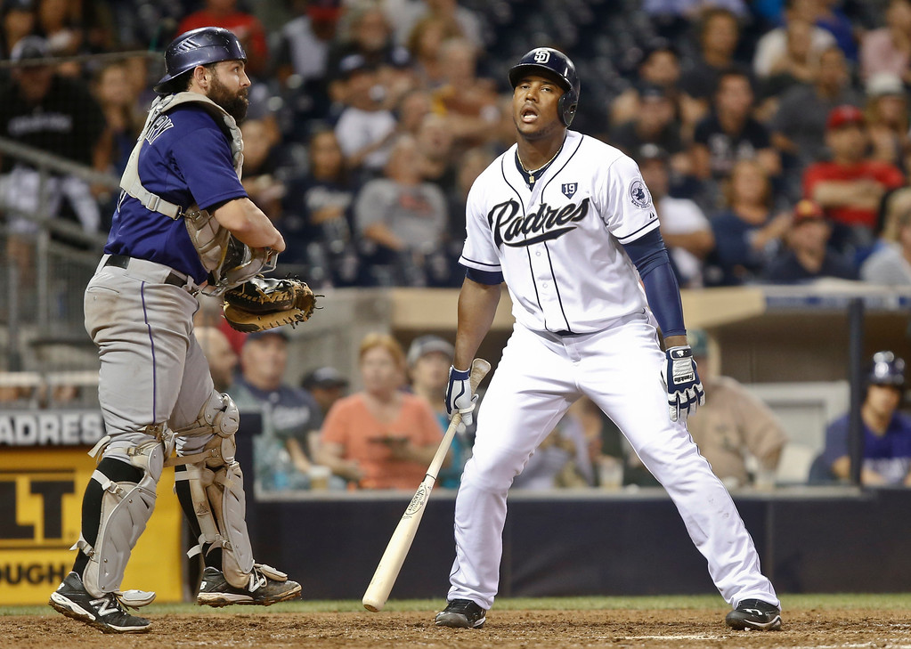 . San Diego Padres\' Rymer Liriano is stunned after taking a called third strike to end the sixth inning with the bases loaded against the Colorado Rockies in a baseball game Monday, Sept. 22, 2014, in San Diego.  Rockies catcher Michael McKenry heads for the dugout.  (AP Photo/Lenny Ignelzi)